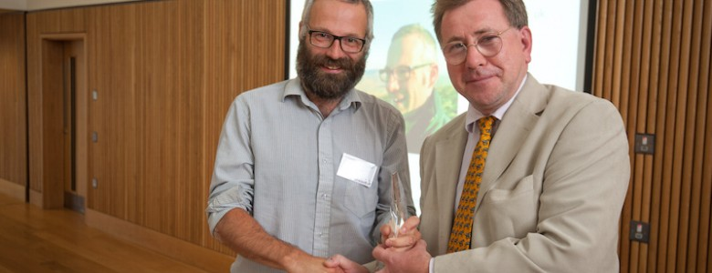 Oxford, UK. 5th September 2015. The second annual Community Energy Awards held at the Said Business School. L-R: Jon Halle (Share Energy) accepting the award for Community Energy Champion from Matt Criddle (Naturesave, sponsor). Photo: Andrew Walmsley
